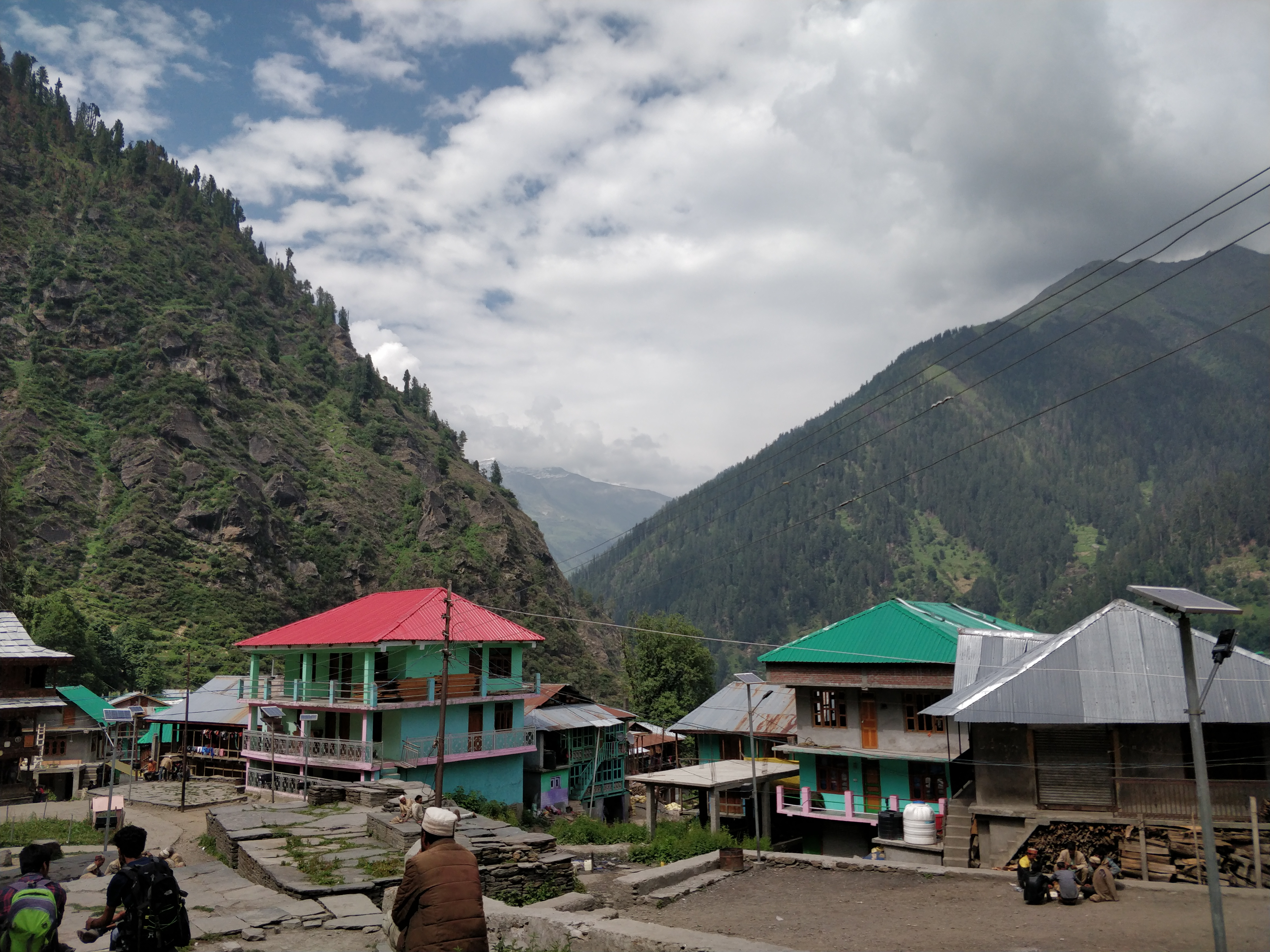View of Malana villagein Himachal Pradesh, India; showing the local houses and residents.